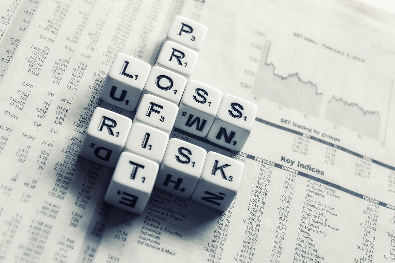 dices over newspaper, profit, loss risk-2656028.jpg